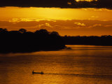 Water Taxi Ferries People across the Madre De Dios River at Sunrise