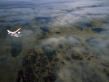 Seaplane over Clouds and the Tundra of Alaska's North Slope  North Slope  Alaska