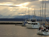 Scene of Boats in a Seattle Marina and the Olympic Mountain Range in the Distance