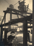 Young Woman Working at a Loom in a Workshop