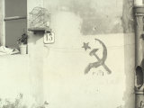 External Wall of a House on Which a Hammer and Sickle and PCI are Written