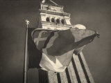 Flag Blowing in the Wind at the Foot of the Bell Tower of St Mark&#39;s in Venice