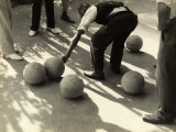 Player Measuring the Distance Between Two Bocce Balls
