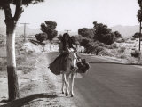 Elderly Woman on a Mule