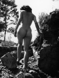 Young Nude Woman Walking Through Nature
