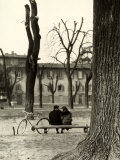 Young Couple Sitting on a Bench in Piazza Donatello in Florence