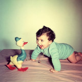 Baby Crawling Next to a Toy Duck