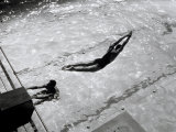 View from Above of a Swimmer Diving