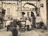 Woman Looking Out onto the Terrace of a Restaurant