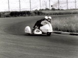 Two Motorcyclists in a Race  on a Two Seater Motorcycle
