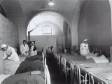 Nurses and Doctors Visiting the Bedridden in the Room of a Hosptial During World War II