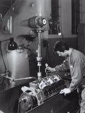 Worker Operating a Machine in the Ferrari Factory