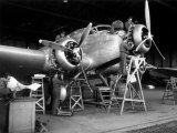 Group of Technicians Building an Airplane Inside a Hangar of Caproni Factory