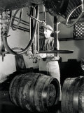 Worker in Front of Some Isobarometric Equipment Inside a Brewery