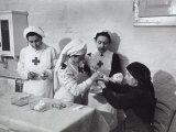 Nurse Attending to an Elderly Woman in a Hosptial During World War II