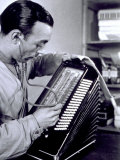 Close-up of a Worker with a Stethoscope  Checking the Perfection of an Accordion under Production