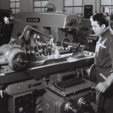 Worker Operating a Machine at the Ferrari Factory
