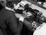 Female Worker Working on a Sewing Machine in the Factory of the Giordani Company