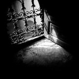 Detail of Window with Ornate Iron Grille and Sunlight Streaming Through  Morocco