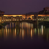 Reflections in the River Arno of Lights on the Ponte Vecchio  Florence  Tuscany  Italy