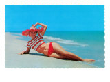 Woman in Red and White Bathing Suit and Hat