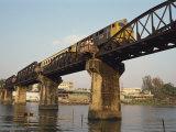 Train Crossing the River Kwai Bridge at Kanchanburi in Thailand  Southeast Asia