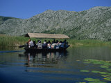 Tourists in Local Boats  Neretva Delta Valley  Croatia  Europe