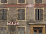 Cafe Sign on an Old Hotel Building with Wooden Shutters at Mauriac in the Auvergne  France