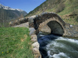 Ancient Stone Bridge over a River in the La Malana District in the Pyrenees in Andorra  Europe