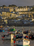Stormy Sky at Sunset with Small Fishing Boats in the Harbour at St Ives  Cornwall  England  UK