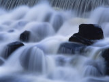 Close-Up of Waterfall  Water Cascading over Rocks in the Highlands of Scotland  United Kingdom