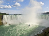 Maid of the Mist Tour Boat under the Horseshoe Falls Waterfall at Niagara Falls  Ontario  Canada