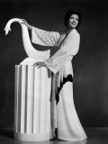 Kay Francis Modeling White-Crepe Lounging Robe with Crimson Trim  1937