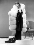 Claudette Colbert  in Travis Banton Gown and White Fox Fur Coat  c1935