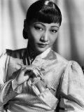 Anna May Wong  in an Orange Nanking Brocade Robe with Sandalwood Fastenings  1937