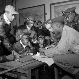 Preflight Briefing of Several Tuskegee Airmen at Ramitelli  Italy  March 1945