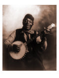 African American Man Seated and Holding Banjo  1911