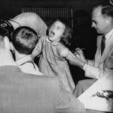 Young Girl Receiving a Vaccine from Dr Hugh Griffin  1950s