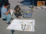 Ham the Chimpanzee and Technician Go over Equipment in Preparation for Launch  January 23  1961
