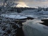 A storm clears along the Mendenhall River after a morning snow