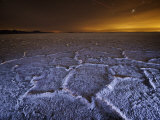The lights of Salt Lake City brushes over the Bonneville Salt Flats