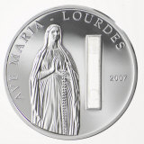 Embedded water from Lourdes in a commemorative coin from Palau