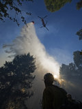 A helicopter makes water drops on a wildfire in Boise National Forest