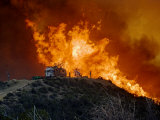 Flames surge up a hillside near the Pacific Coast Highway in Malibu