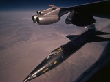 An X-15 rocket plane drops free of a B-52