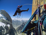 A climber rappels down to his hanging tent 2 000 feet above the ground