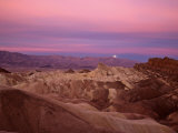 Full moon setting over Manly Beacon at Zabriskie Point