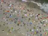 Aerial view of wall-to-wall seaside sunbathers