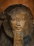 As a sphinx  Hatshepsut displays a lion's mane and a pharaoh's beard
