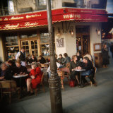 Tourists Sitting at a Sidewalk Cafe  France